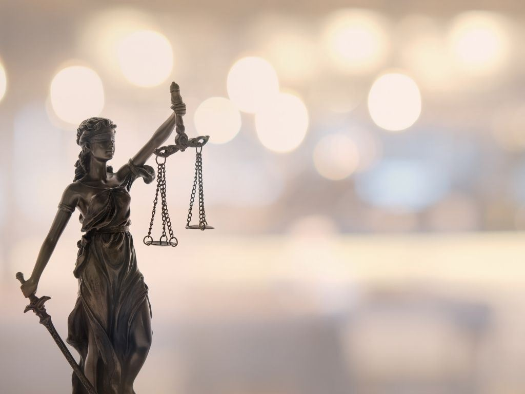 lady justice weighing the west Virginia auto accident process