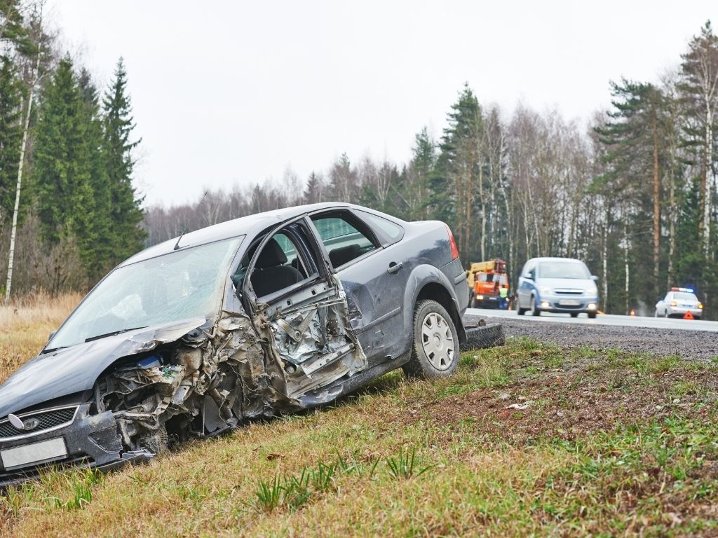 car in a ditch from a intersectional t bone accident